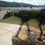 Wolf sculpture with Stillwater lift bridge and the  wilds of Wisconsin behind